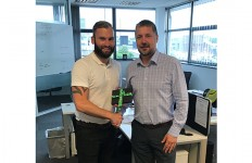 BMA266 Dean Hodges (right) of BM Aluminium presents the prize from its FIT Show football break prize draw