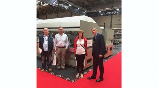 L-R Tom Bowland, John Cowley and Mary O'Sullivan from Classic pictured alongside their new Comet T6HP machining centre at the FIT Show with Jim O'Connell from Emmegi (UK)