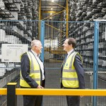 VEKA Group MD David Jones (left) shows George Osborne the warehouse during the factory tour.