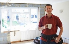 Builder Carrying Out Home Improvements Taking A Break