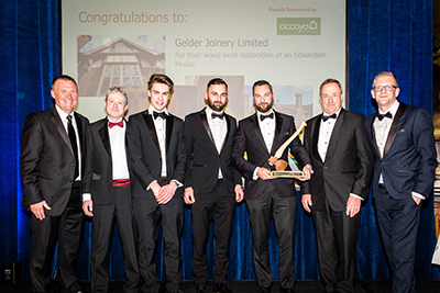 The Gelder Joinery Limited team at the awards with Guest Speaker Graham Poll (l) and BWF CEO Iain McIlwee (r))